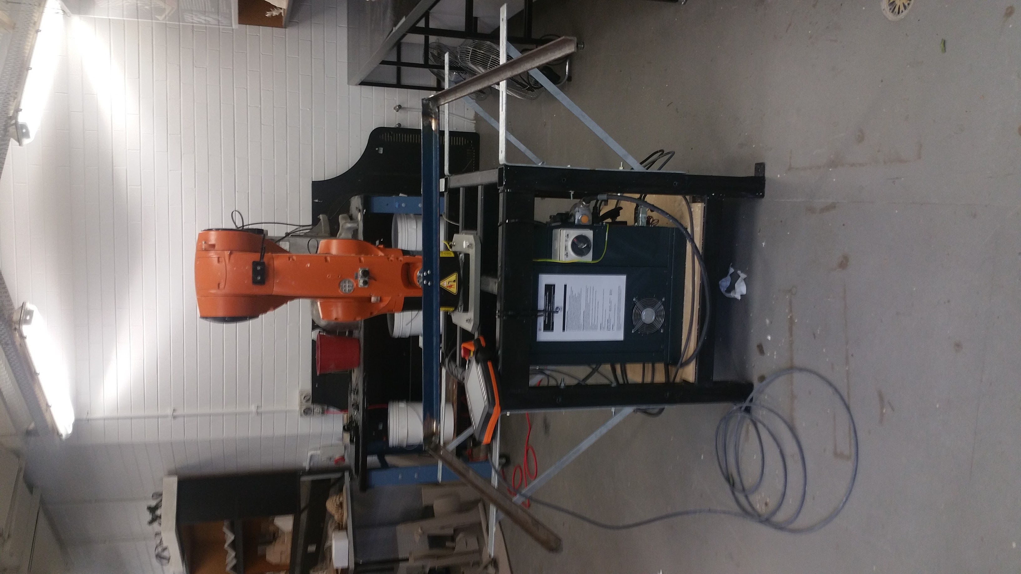 KUKA robot with wire cutter attachment